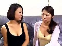 Japanese Lesbians Suck Nipples On Couch