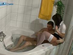 Glam babe gives a wet bathroom blowjob