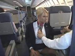 Naughty flight attendant giving a blowjob