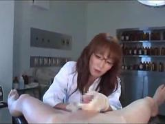 Sexy Japanese doctor gives her patient a handjob