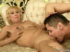 Mature blonde fucking with boy