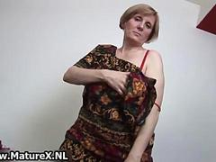 Dirty old housewife is stripping
