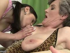 Teen babe sucks on the grannies nipples real hard