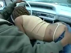 Slutty black girl gives a blowjob in a car