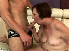Fat ugly short-haired granny fucks a young stud
