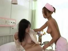 Busty Asian nurse plays with a female patient