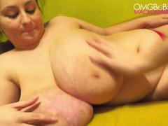 Big fat babe groping her chunky boobs