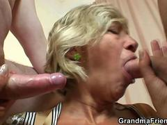 Two dudes fuck a blonde grannies face