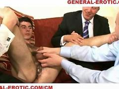 Two older men play with a tiny twink