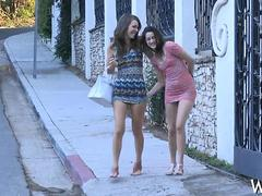 Brunette lesbians fool around in public and rub their twats