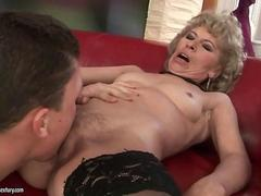 Granny in black stockings gets fucked on sofa