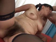 Hairy brunette granny banging her brains out with a young stud