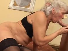 Granny with gray hair fucking and sucking dick in stockings