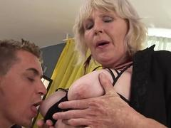 Mature blonde with freckled skin sucking a big young dick