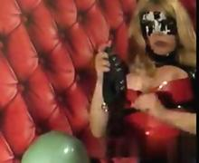 Busty blonde shemale fucking her brains out in leather