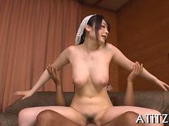 Asian wife with big boobs climbs a hard cock
