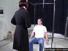 Pale redhead domina in leather lingerie punishing her young lover