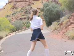 Cute schoolgirl lets her hair down with fingering session