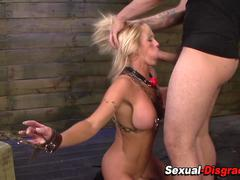 Chained milf rides sybian
