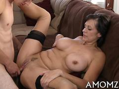 Mature bitch with huge boobs gets nailed by a young stud