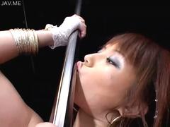 Brown haired Asian darling in pink dancing around the pole