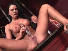 Pole dancer Christina Bella toying dildo at the stage