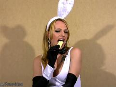 Shemale bunny in black stockings masturbates her big shaft