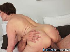 Good looking grandma loves being fucked by a young hunk