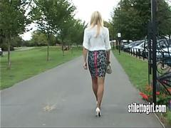 Beautiful blonde Stiletto Girl with great legs teasing her sexy white high heels