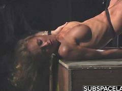 A blonde kinky slut is being tied up and abused for her fetish satisfaction
