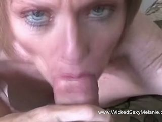 slutty granny gets down on her knees to suck