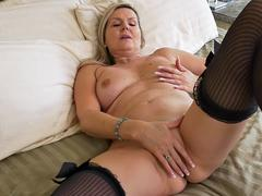 horny blonde milf fills herself with a toy