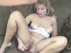 Busty housewife Lissa fucks her mature twat with a toy