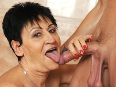 Horny granny is tempted to take that large member and suck it before spreading her legs for this lad